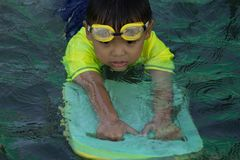 Children swimming. Boy Practice Swimming. Activities on the pool. Playing in water, happiness and holiday royalty free stock photos