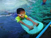 Children swimming. Boy Practice Swimming. Activities on the pool. Playing in water, happiness and holiday stock photos