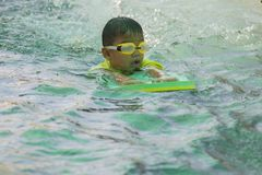 Children swimming. Boy Practice Swimming. Activities on the pool. Playing in water, happiness and holiday stock images