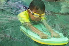 Children swimming. Boy Practice Swimming. Activities on the pool. Playing in water, happiness and holiday royalty free stock images