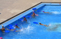 Children swimming competition finish Royalty Free Stock Image