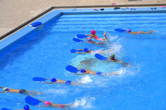 Children swimming competition stock images