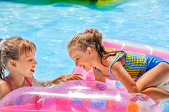 Children swimming on inflatable beach mattress Royalty Free Stock Photography