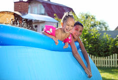 Children swimming in a inflatable swimming pool Royalty Free Stock Photo