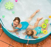 Children swimming in kid pool Royalty Free Stock Photos