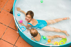 Children swimming in kid pool Stock Images