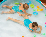 Children swimming in kid pool Royalty Free Stock Photography