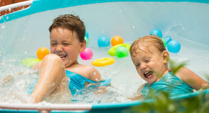 Children swimming in kid pool Stock Photography