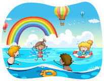 Children swimming in the ocean Stock Image