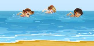 Children swimming in the ocean Stock Photo