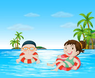 Children swimming in the ocean Royalty Free Stock Photography