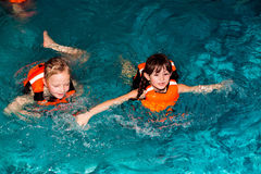 The children. Children swimming in the pond and swim Royalty Free Stock Photo