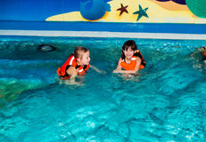 The children. Children swimming in the pond and swim Royalty Free Stock Image