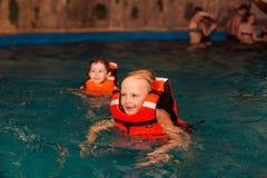 The children. Children swimming in the pond and swim Stock Image
