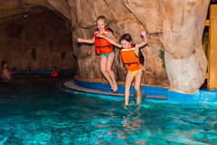 The children. Children swimming in the pond and swim Stock Images
