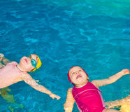 Children in a swimming pool Stock Images