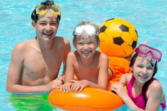 Children in swimming pool royalty free stock photography