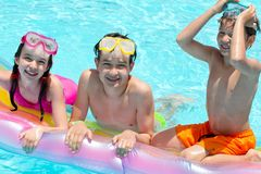 Children in swimming pool Royalty Free Stock Photos