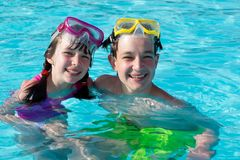 Children in swimming pool. Boy and girl together in swimming pool Stock Images
