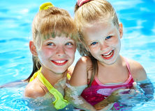 Children in swimming pool. Summer outdoor stock images