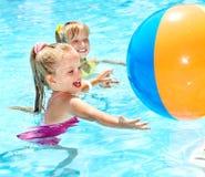 Children swimming in pool. Stock Photo