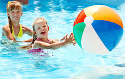 Children swimming in pool. Royalty Free Stock Images