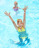 Children in swimming pool. Summer outdoor royalty free stock photos