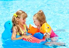 Children  in swimming pool. Royalty Free Stock Image