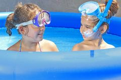 Children in the swimming pool Stock Photography