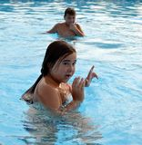 Children in swimming pool Stock Photo
