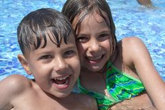Children in the swimming pool. Smiling children in the swimming pool of water park in sunny summer day Stock Photography