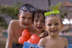 Children in swimming-pool. Happy family stock images