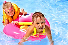 Children  in swimming pool. Child with armbands in swimming pool Stock Photo