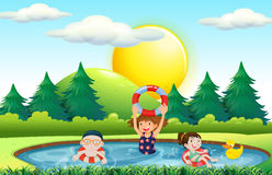 Children swimming in the pool Royalty Free Stock Images