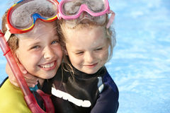 Children in swimming pool learning snorkeling. Sport Stock Images