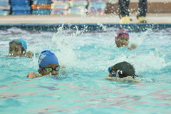 Children in the swimming pool. NAKHON SI THAMMARAT, THAILAND - MARCH 2: Asian Thai children in the swimming pool at the leisure center on March 2, 2016 in Nakhon royalty free stock image