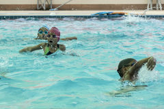 Children in the swimming pool. NAKHON SI THAMMARAT, THAILAND - MARCH 2: Asian Thai children in the swimming pool at the leisure center on March 2, 2016 in Nakhon stock images