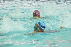 Children in the swimming pool. NAKHON SI THAMMARAT, THAILAND - MARCH 2: Asian Thai children in the swimming pool at the leisure center on March 2, 2016 in Nakhon stock photos