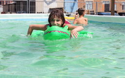 Children swimming in the pool Stock Photography
