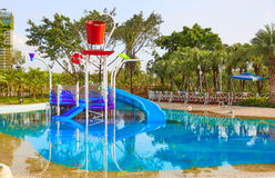 children swimming pool with water slide Royalty Free Stock Photo