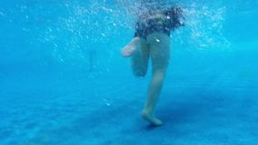 Children in swimming pool under water slow motion stock video