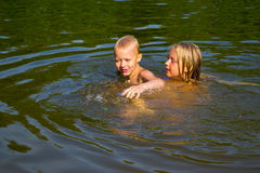 Children swimming in the river Royalty Free Stock Photos