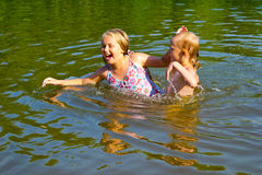 Children swimming in the river Stock Image