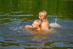 Children swimming in the river Stock Photo