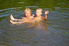 Children swimming in the river Royalty Free Stock Image