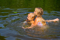 Children swimming in the river Royalty Free Stock Photo