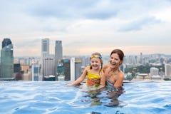 Kids swim in Singapore roof top swimming pool Stock Photo