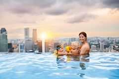 Kids swim in Singapore roof top swimming pool Royalty Free Stock Images