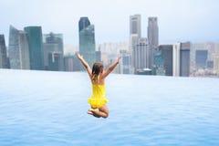 Kids swim in Singapore roof top swimming pool Royalty Free Stock Image
