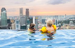 Kids swim in Singapore roof top swimming pool Stock Images